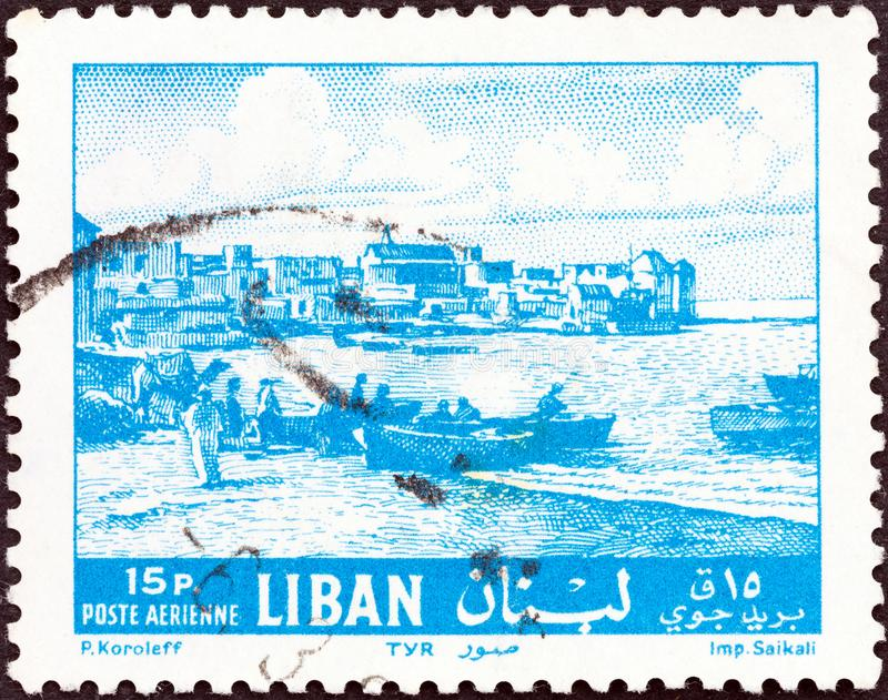 LEBANON - CIRCA 1961: A stamp printed in Lebanon shows Tyre waterfront, circa 1961. royalty free stock images