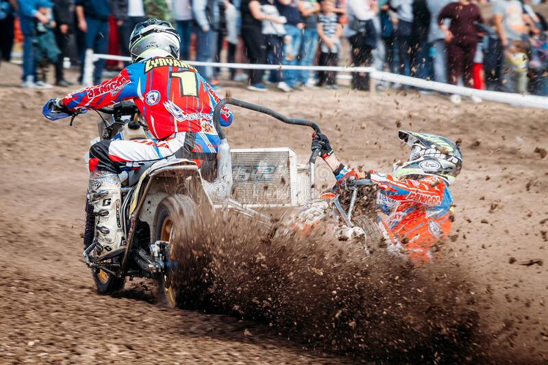 Lebedyanka, Russia - August 25, 2019: Russian Motocross Championship, motocross racer accelerating in dirt track royalty free stock photography