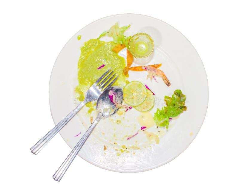 Lebensmittelabfälle, nachdem Steak, Fischsauce, Paprika, Kalk, purpurroter Kohl, Garnele und schmutziger Löffel im Teller gegesse stockbilder