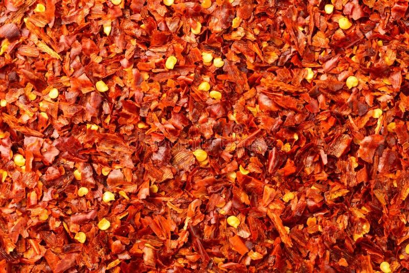 Lebensmittelhintergrund von getrockneten Flocken des roten Pfeffers, Draufsicht stockfotos