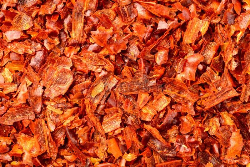 Lebensmittelhintergrund von getrockneten Flocken des roten Pfeffers, Draufsicht lizenzfreies stockfoto
