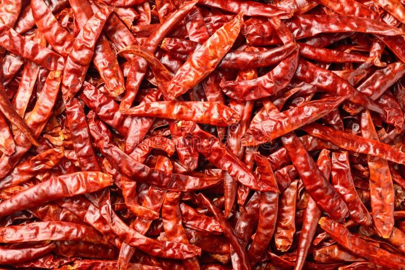 Lebensmittelhintergrund von getrockneten roten Paprikas, Draufsicht lizenzfreies stockbild