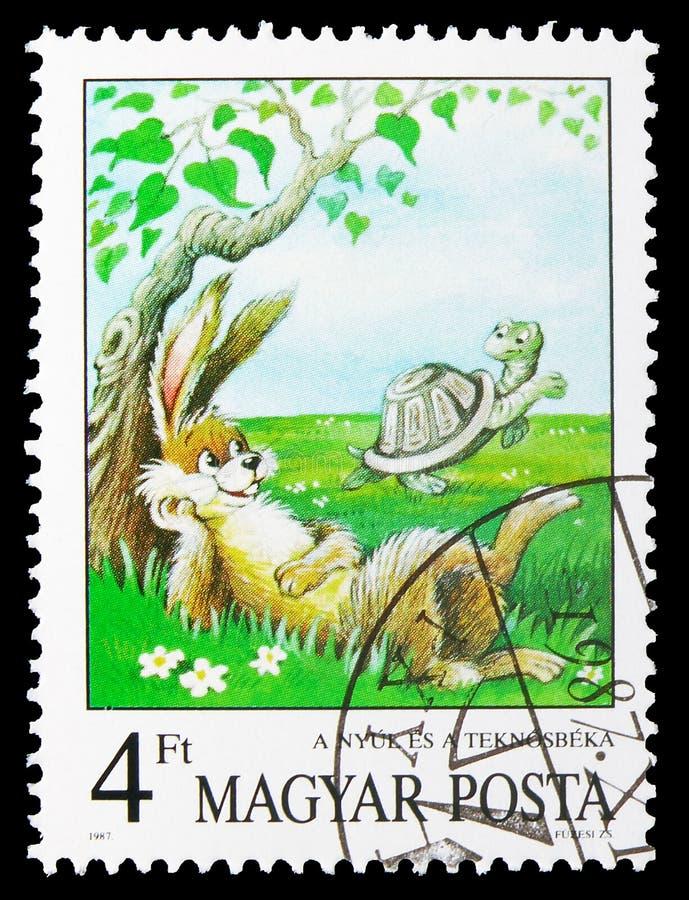 A Lebre e a Tartaruga, as fábulas de Esopo, serie dos contos de fadas, cerca de 1987 imagem de stock royalty free