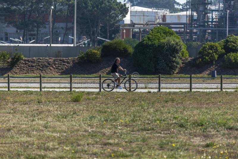 View of cyclist, cycling ,on the eco pedestrian / bike path, Leca da Palmeira, royalty free stock images