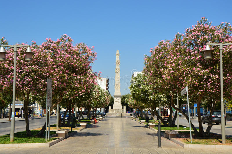 LECCE, ITALY - AUGUST 2, 2017: Piazzetta Arco di Trionfo square with the obelisk in the background, Lecce, Italy stock image