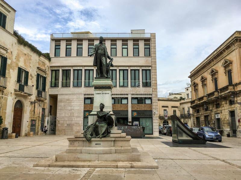 The statue called Monumento a Sigismondo Castromediano on a pedestal in Lecce, Italy stock image