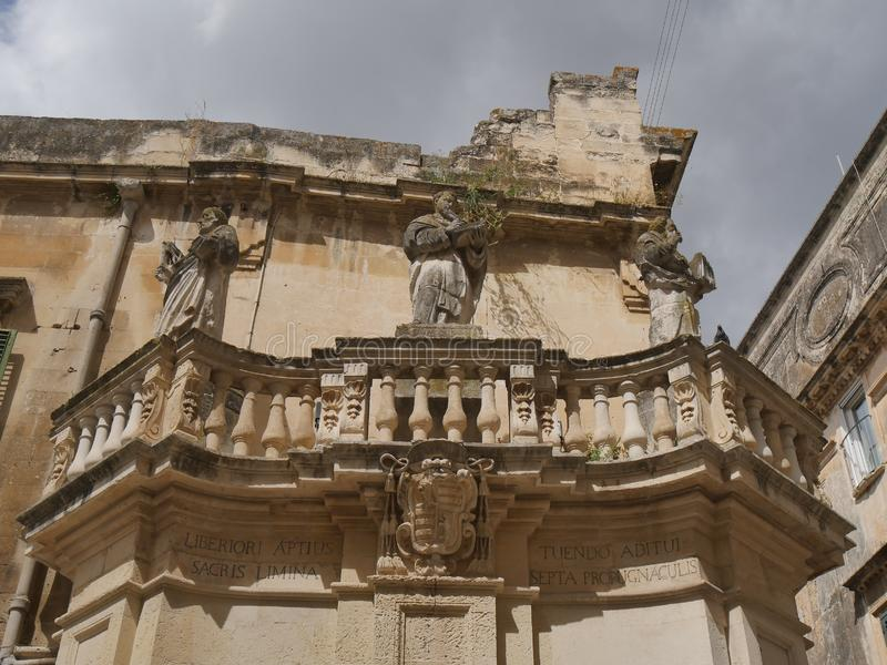 Lecce - Piazza Duomo propylaea. Propylaea in the entrance of Piazza Duomo are two opposite balconies in baroque style supporting the statues of  st Oronzo, Irene stock photo