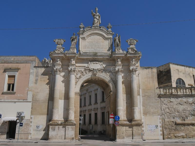 Lecce - Rudiae Gate. It is one of the ancient entrance in the city and it was built in baroque style. In its facade take place st Oronzo statue and hight stock photo