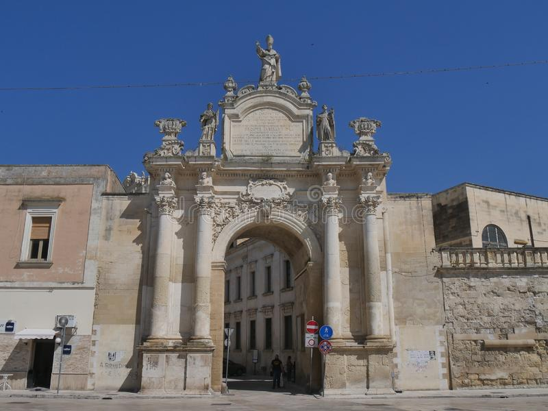 Lecce - Rudiae Gate. It is one of the ancient entrance in the city and it was built in baroque style. In its facade take place st Oronzo statue and hight stock photos