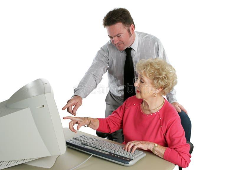 Lección mayor de la señora ordenador fotos de archivo