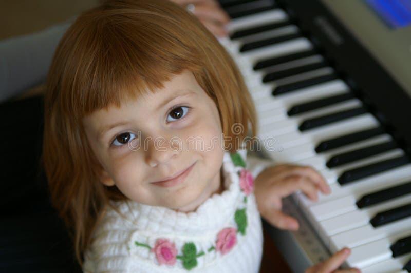 Lecciones de piano imagen de archivo