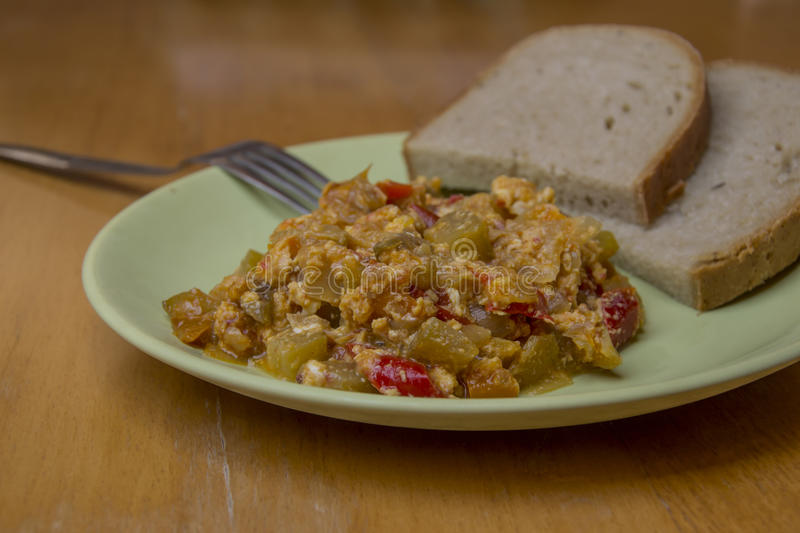 Lecho, hungaria tradition food with bread and spoon royalty free stock photo
