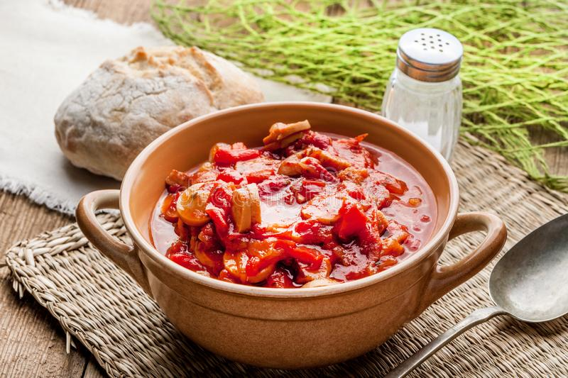Lecho - stew with peppers, onions and sausages. Lecho - tasty Hungarian stew with peppers and sausage royalty free stock photography