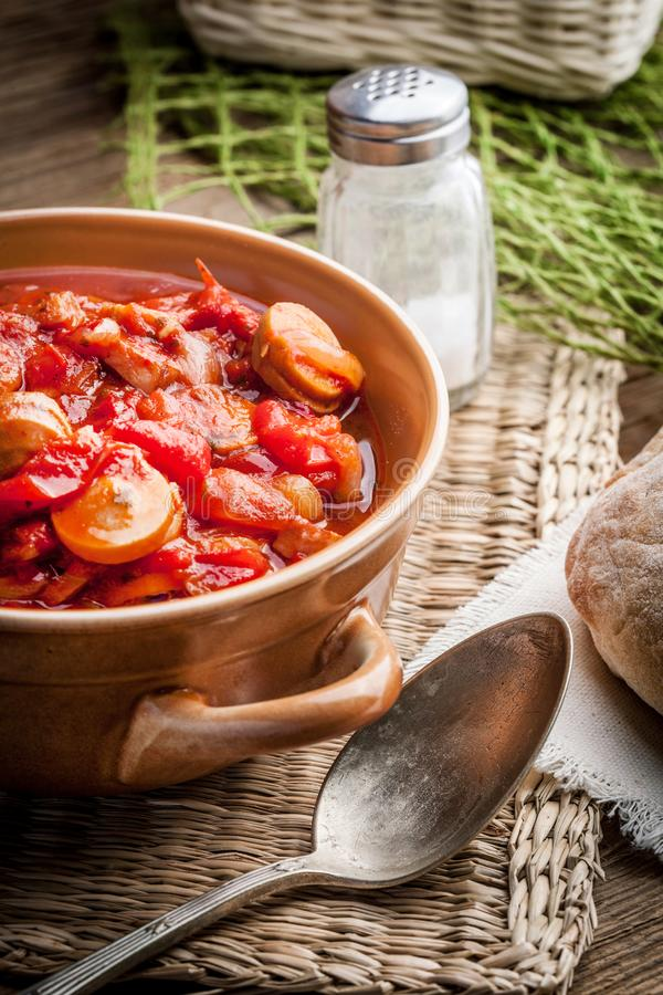 Lecho - stew with peppers, onions and sausages. Lecho - tasty Hungarian stew with peppers and sausage stock images