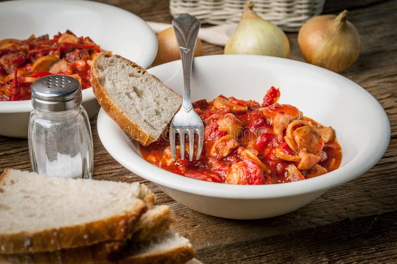 Lecho - stew with peppers, onions and sausages. Lecho - tasty Hungarian stew with peppers and sausage royalty free stock image