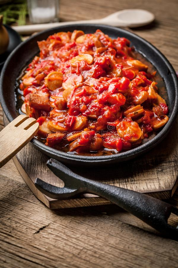 Lecho - stew with peppers, onions and sausages. Lecho - tasty Hungarian stew with peppers and sausage stock photo