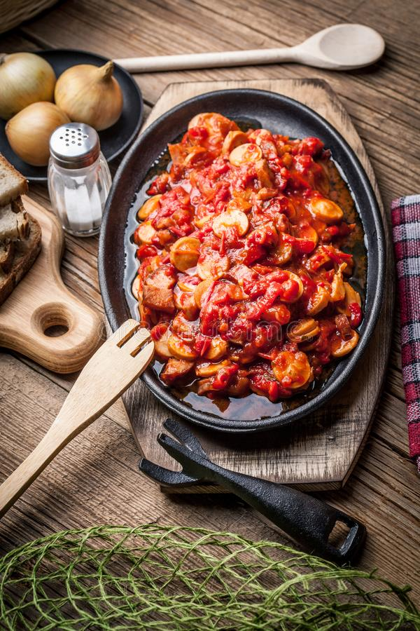 Lecho - stew with peppers, onions and sausages. Lecho - tasty Hungarian stew with peppers and sausage stock photography