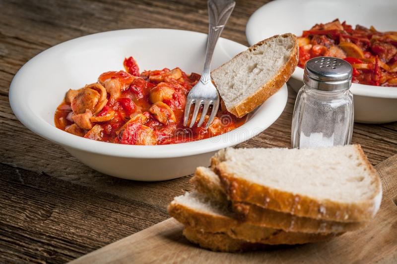 Lecho - stew with peppers, onions and sausages royalty free stock photo