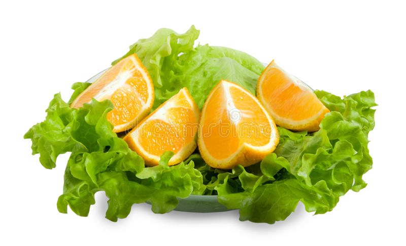 Lechuga y halfs de la naranja foto de archivo