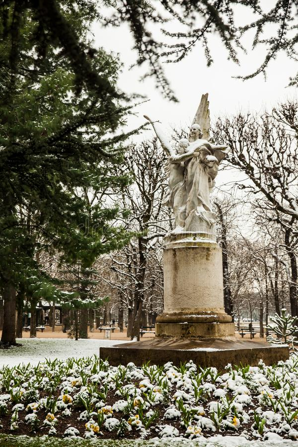Leconte de Lisle statue at the Luxembourg Palace garden in a freezing winter day day just before spring. PARIS, FRANCE - MARCH, 2018: Leconte de Lisle statue at stock photography