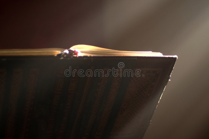 Lectern in altar with a holy bible. Lectern in a church with a holy bible and a ray of divine light royalty free stock images