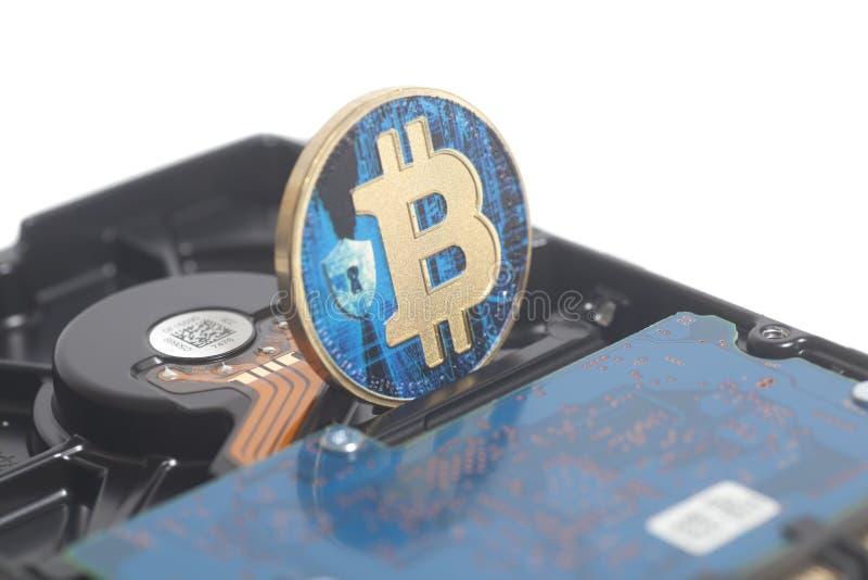Lecteur de disque dur avec Bitcoin photographie stock