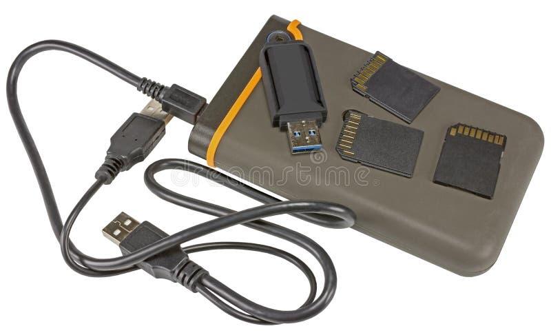 Lecteur de disque dur externe et éclair d'Usb sur le blanc photographie stock