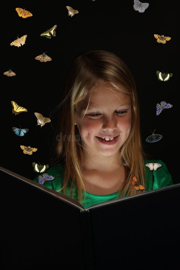 Lecteur de livre d'imagination images stock