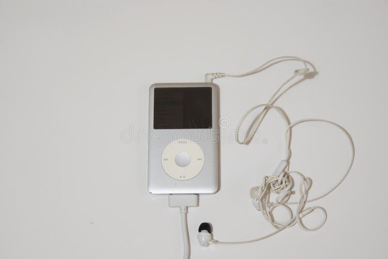 LECTEUR MP3 ET EARBUDS image libre de droits