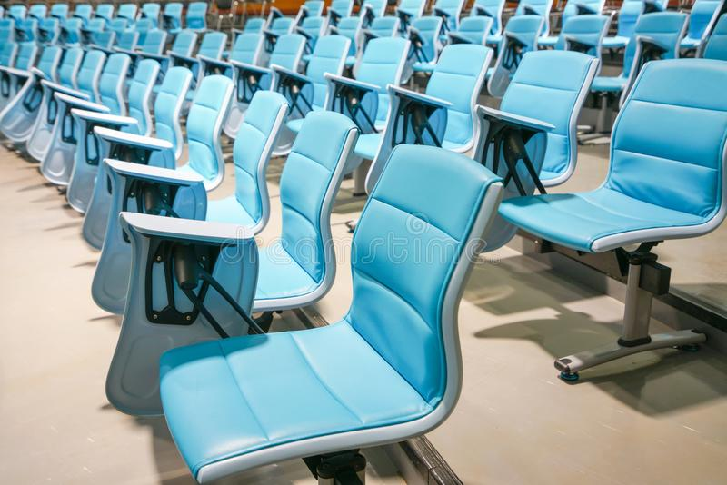 Lecture chairs in empty lecture hall. royalty free stock photography