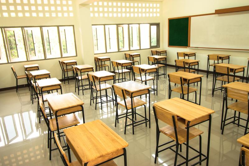Lecture room or School empty classroom with desks and chair iron stock photography