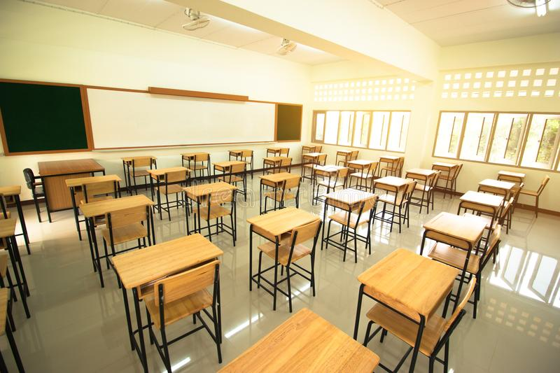 Lecture room or School empty classroom with desks and chair iron stock photo