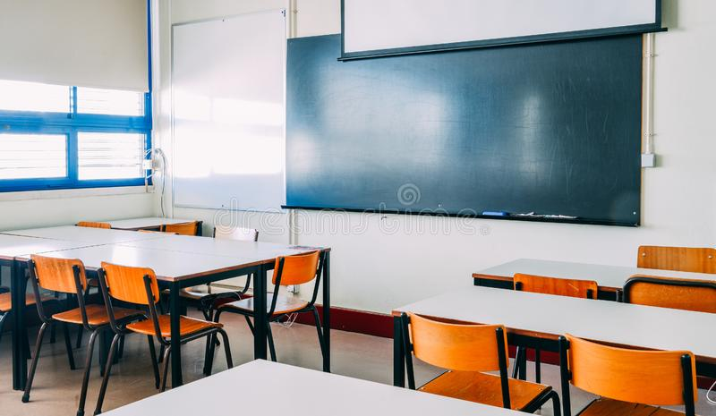 Lecture room or School empty classroom with desks and chair iron wood for studying lessons in high school thailand stock photo