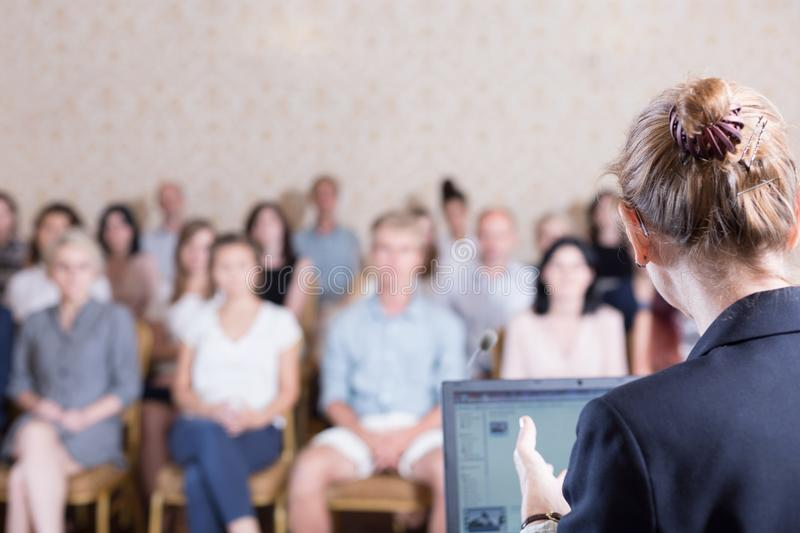 Lecturer giving speech during conference. Image of lecturer giving speech during academic conference stock photography