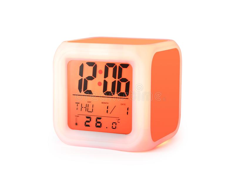 LED alarm clock isolated on white background. Modern style digital display.  Clipping paths object  Orange color stock photography