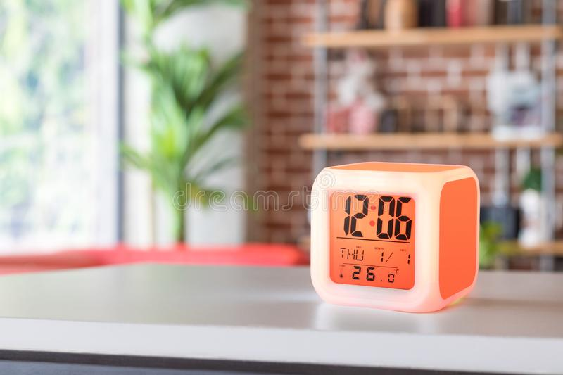 LED alarm clock standing on table background. Digital timer display. Copyspace for your design royalty free stock photography