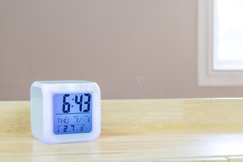 LED alarm clock standing on table background. Digital timer display. Copyspace for your design royalty free stock photos