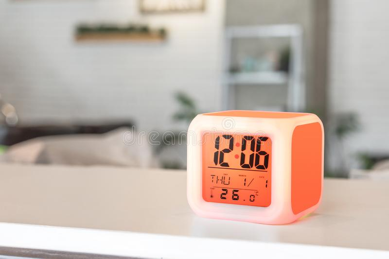 LED alarm clock standing on table background. Digital timer display. Copyspace for your design stock photo