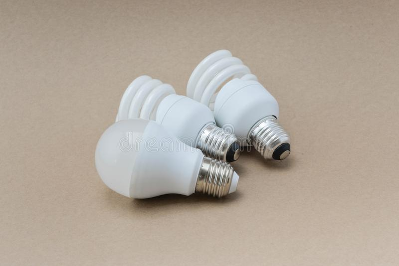 LED bulb and Fluorescent bulb. The choice of lighting for saving royalty free stock image