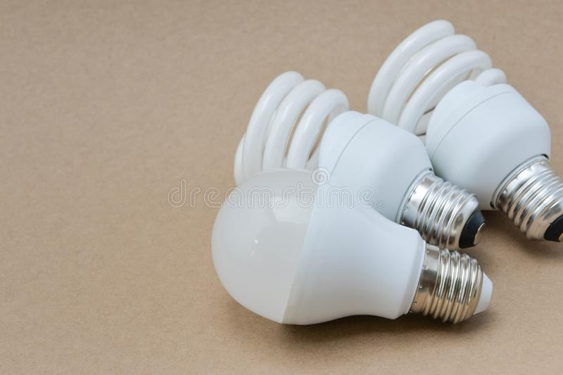 LED bulb and Fluorescent bulb. The choice of lighting for saving royalty free stock photography