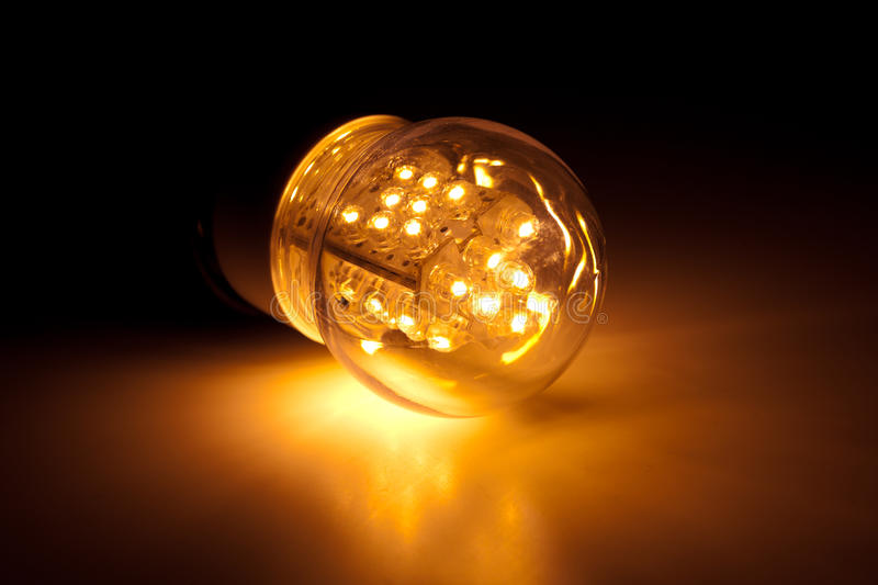 Led bulb light. Yellow led bulb light on the floor stock image