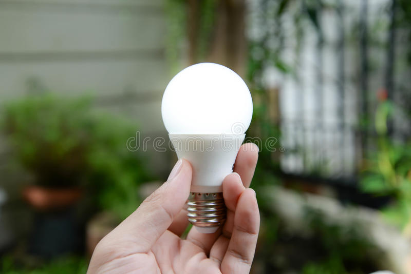 LED bulb with lighting - New technology of energy stock photos