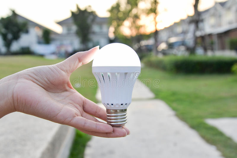 LED Bulb - saving technology in our hand. Hand hold LED Bulb - saving technology in our hand stock images