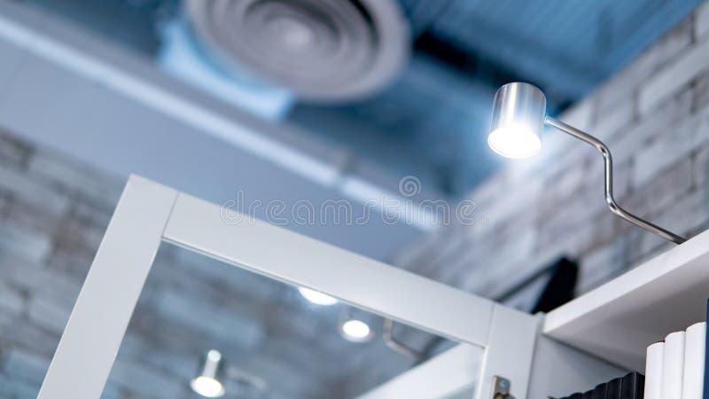 LED Cabinet lighting on the top bookshelf. LED Cabinet lighting on the top of bookshelf. Lighting design concept stock photography