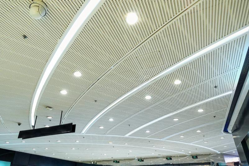 Led  ceiling light  in modern commercial  building. Led light used in modern construction, subway station, airport, railway station, bus station ,shopping mall royalty free stock photo
