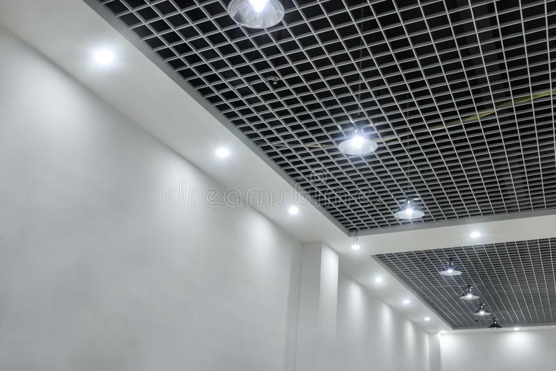 Led ceiling lights on modern commercial building suspended ceiling download led ceiling lights on modern commercial building suspended ceiling stock image image of bokeh aloadofball Images