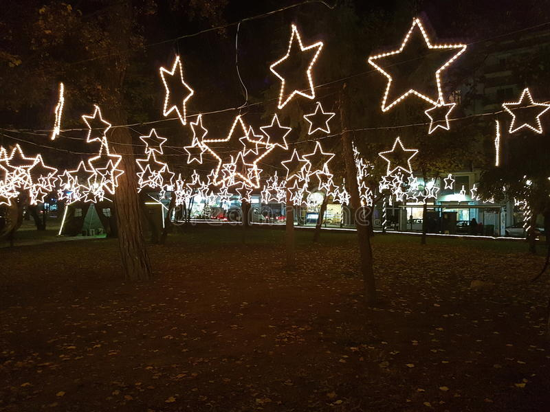 Led Christmas stars at the trees stock photos