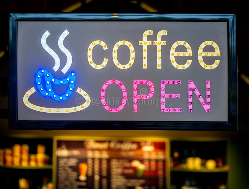 LED coffee shop sign. Colorful LED coffee shop sign. `Coffee open` light box sign in front of coffee shop royalty free stock photos
