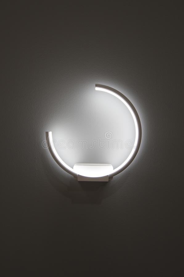 Free LED Decoration Lights Idea On Wall Create Shape With Light And Shadow. Modern Wall Lamp In The Form Of A Ring Isolated On A Gray B Royalty Free Stock Photography - 120287687