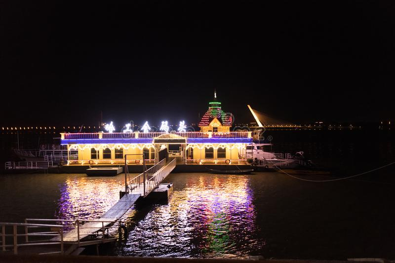 LED electric lighted riverboat in Harbin China against twilight sky stock images